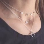 Collar luna invertida, collar elefante y collar medallitas en plata