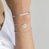 Pulsera concha, cadena plana y elástica bolitas en plata