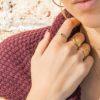 Anillo estrella polar con zirconita, anillo curvas cruzadas y anillo con piedra semipreciosa onix verde en plata bañada en oro