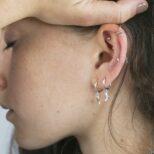 Pendientes aro con luna, pendientes aro conestrella, pendientes rayo mini y ear cuff barras cruzadas en plata