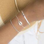 Pulsera cadena plana, pulsera elástica bolitas y pulsera concha en plata